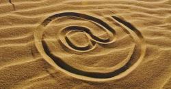 At symbol drawn in sand