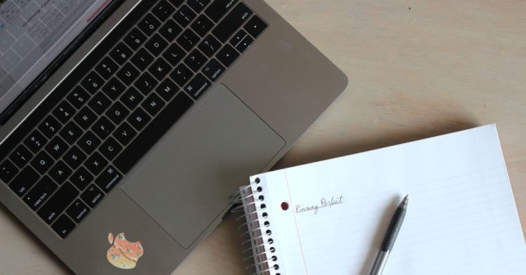 Laptop and notebook with Pinning Perfect written on page