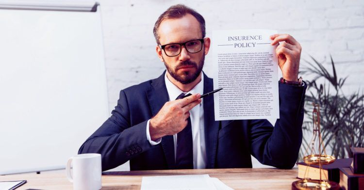Insurance agent pointing at policy