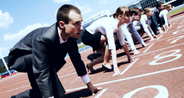 People dressed for business on starting line of a race